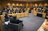 the audience listening to president masisi